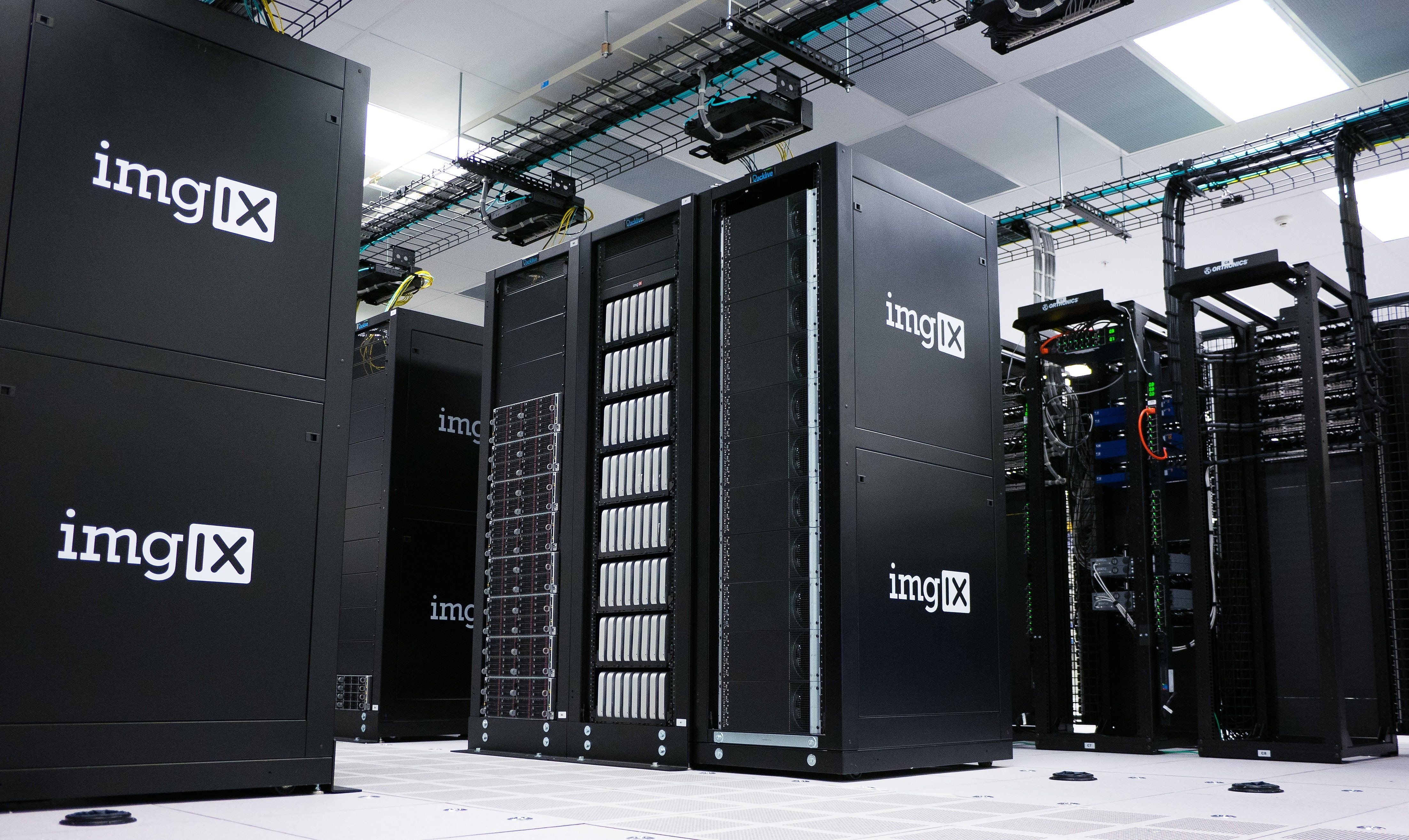 Large black imgIX servers in a server room